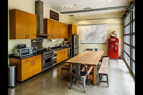 Stewart Perry Construction - kitchen with aluminum and glass sectional doors